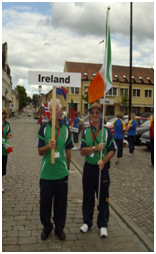 Athletes with Flag and Ireland sign